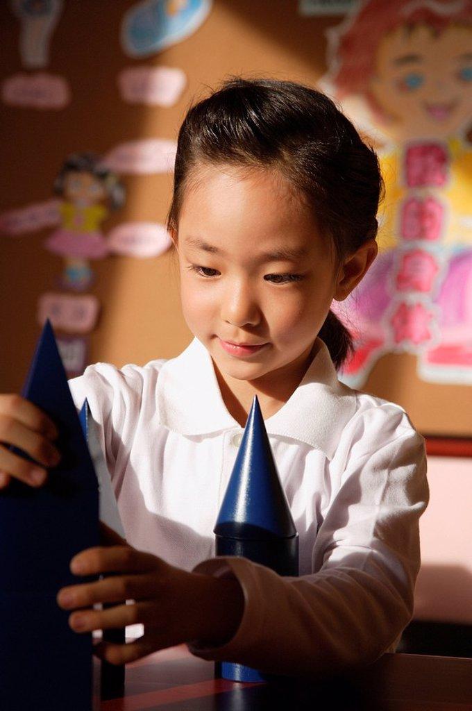 Stock Photo: 4065-5909 Schoolgirl with building blocks