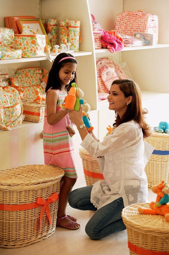 mother and daughter in toy store : Stock Photo