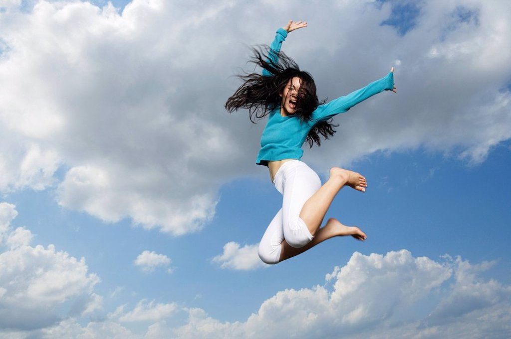 Stock Photo: 4065-6208 young lady jumping in midair
