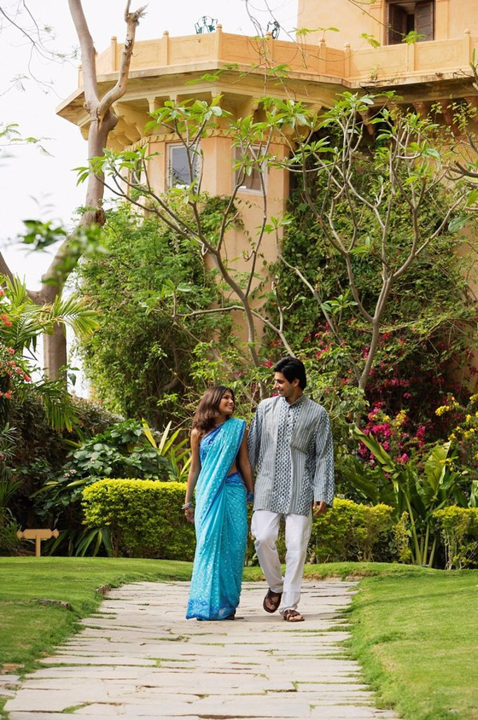 Stock Photo: 4065-6647 young couple strolling in garden