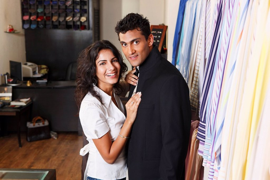 Stock Photo: 4065-7424 couple shopping for men´s clothing