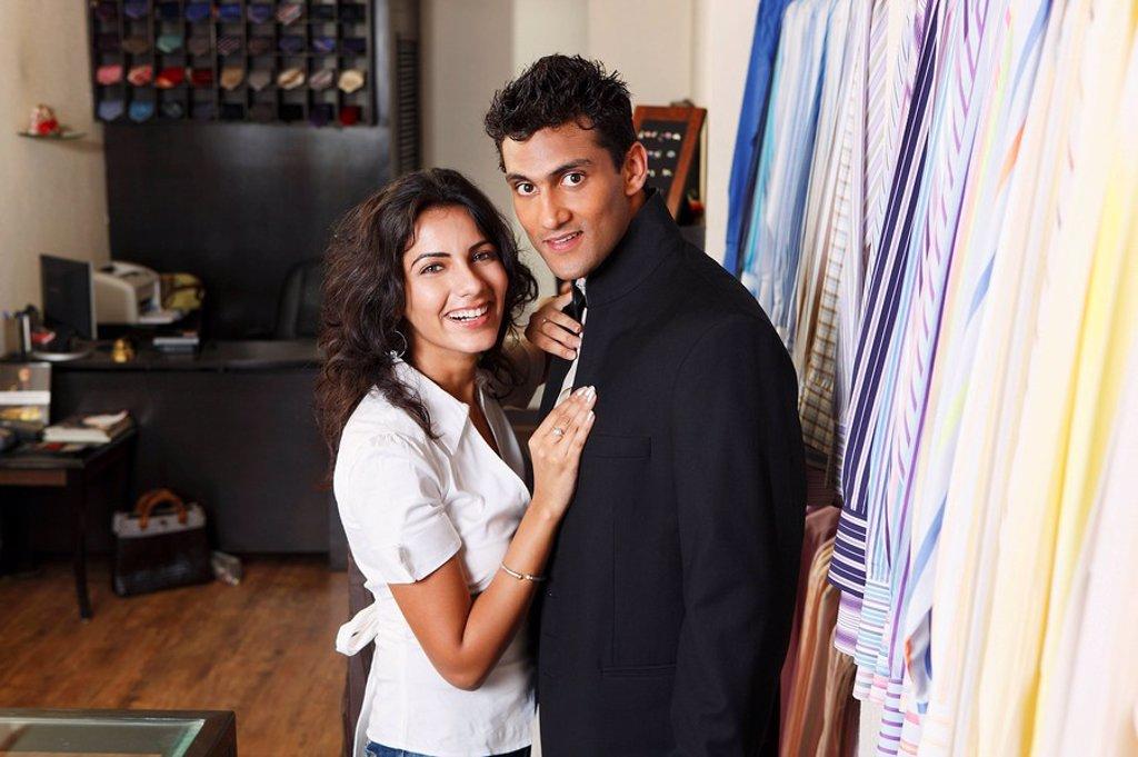 couple shopping for men´s clothing : Stock Photo