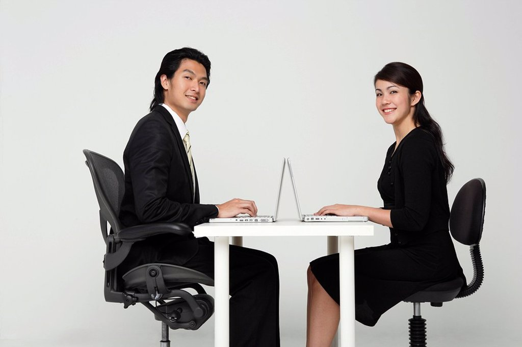 business colleagues working at computers : Stock Photo