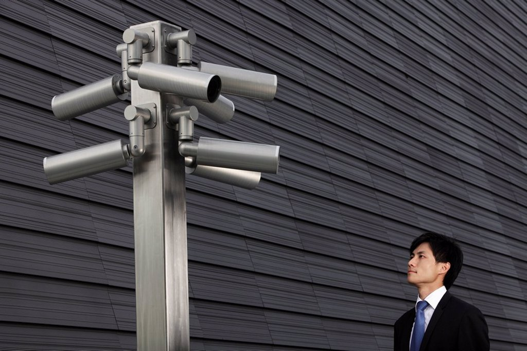 Stock Photo: 4065-7627 Man looking at surveillance cameras