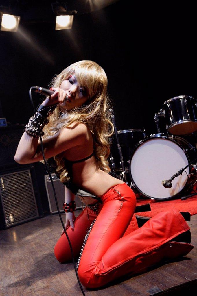 Stock Photo: 4065-8694 rock band woman singing