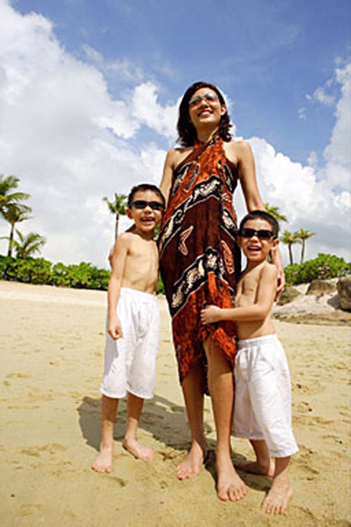 Stock Photo: 4065-9253 Mother with two boys, standing on beach, portrait