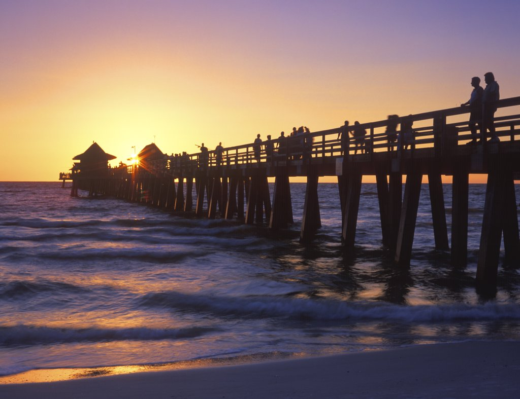 Sunset over Naples Pier, Florida, USA. September 2004 : Stock Photo