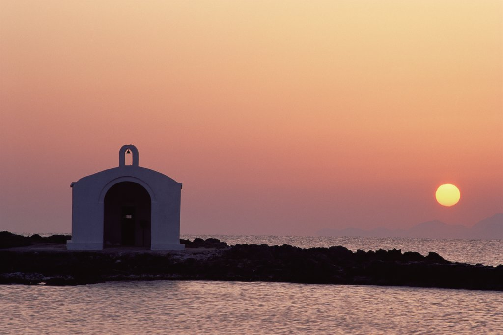 Greek orthodox church at sunset, Georgioupoli, Crete April 1996 : Stock Photo
