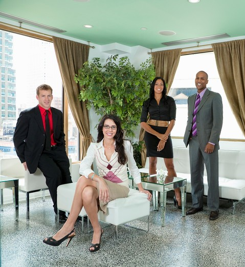 Portrait of business executives in a hotel lounge : Stock Photo