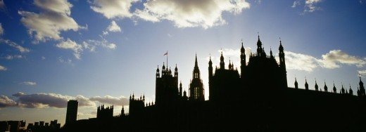 Houses of Parliament silhouetted at sunset, London, UK : Stock Photo