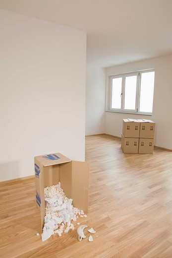 Stock Photo: 4073R-2580 Stack of cardboard boxes in empty apartment, Munich, Bavaria, Germany