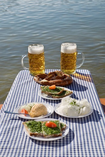 Stock Photo: 4073R-4349 Traditional Bavarian meal on table with beer in beer garden, Munich, Germany