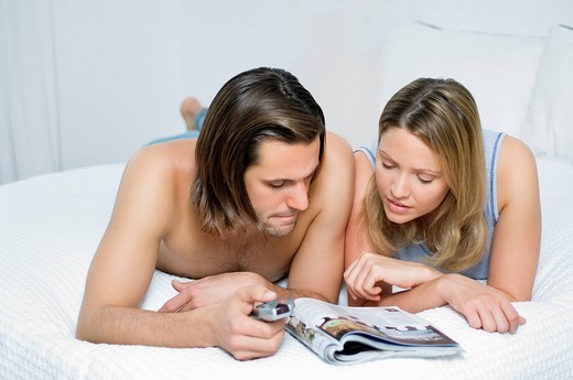 Young couple choosing TV programme : Stock Photo