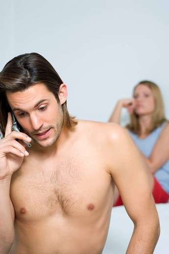 Stock Photo: 4073R-4506 Couple in bedroom ignoring each other