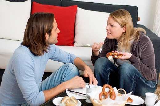 Young couple arguing at breakfast table : Stock Photo