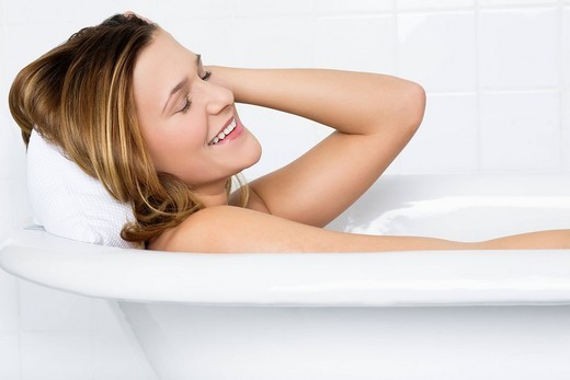 Stock Photo: 4073R-4525 woman having a bath