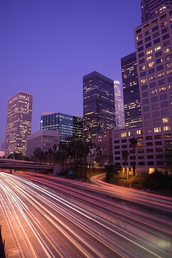 Stock Photo: 4073R-5051 Freeway traffic and skyscrapers at night, Downtown Los Angeles, California, USA