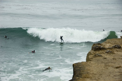 Group of people surfing in an ocean, Steamer Lane, Santa Cruz, California, USA : Stock Photo