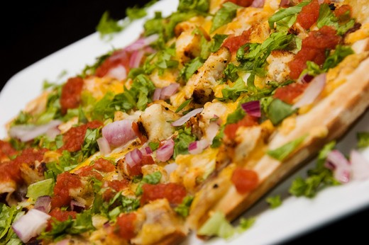 Stock Photo: 4076R-313C Close-up of a Mexican pizza with toppings of vegetables