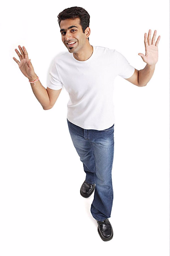 Man looking at camera, arms open, palms showing : Stock Photo