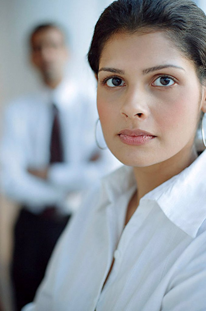 Female executive looking at camera, portrait : Stock Photo