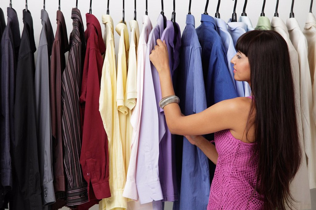 Stock Photo: 4078R-1441 woman looking at rack of clothes