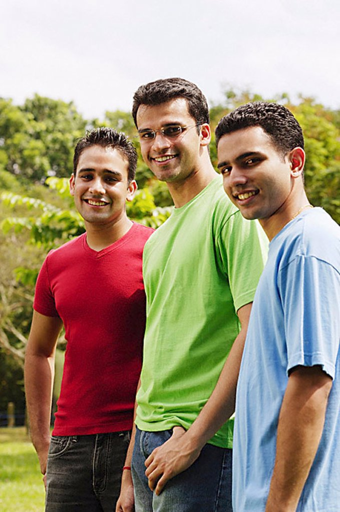 Stock Photo: 4078R-2842 Young men standing side by side, looking at camera