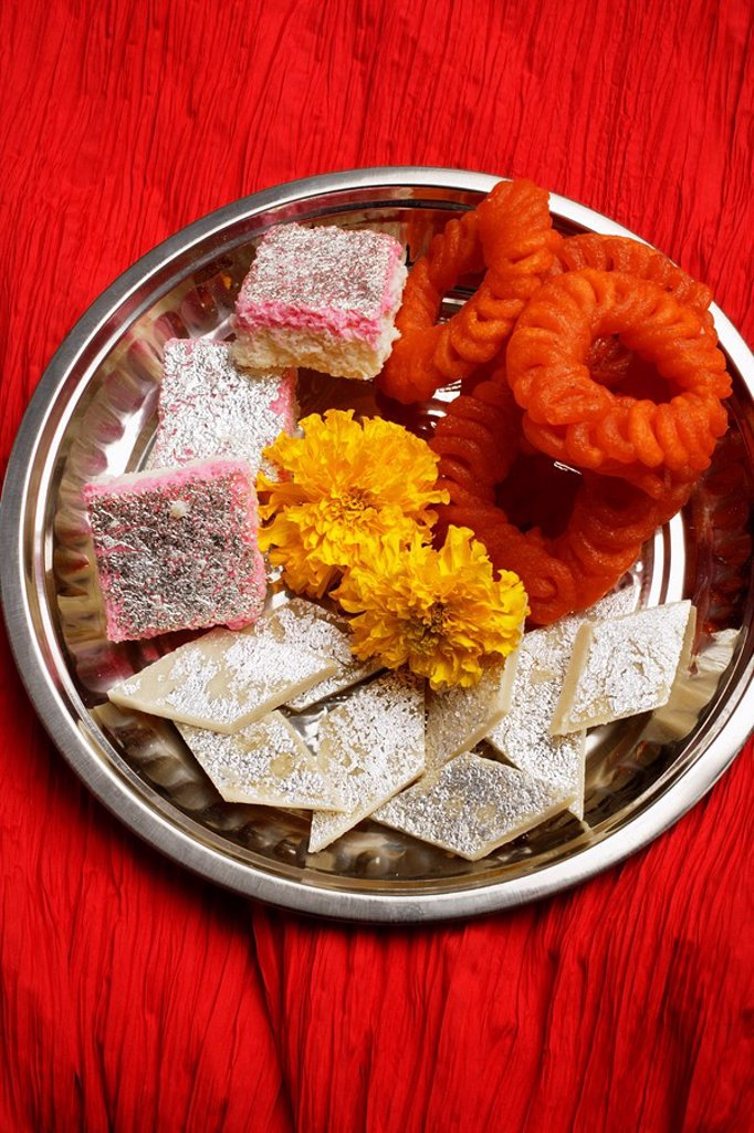 Stock Photo: 4078R-2978 Assorted Indian sweets on silver tray.