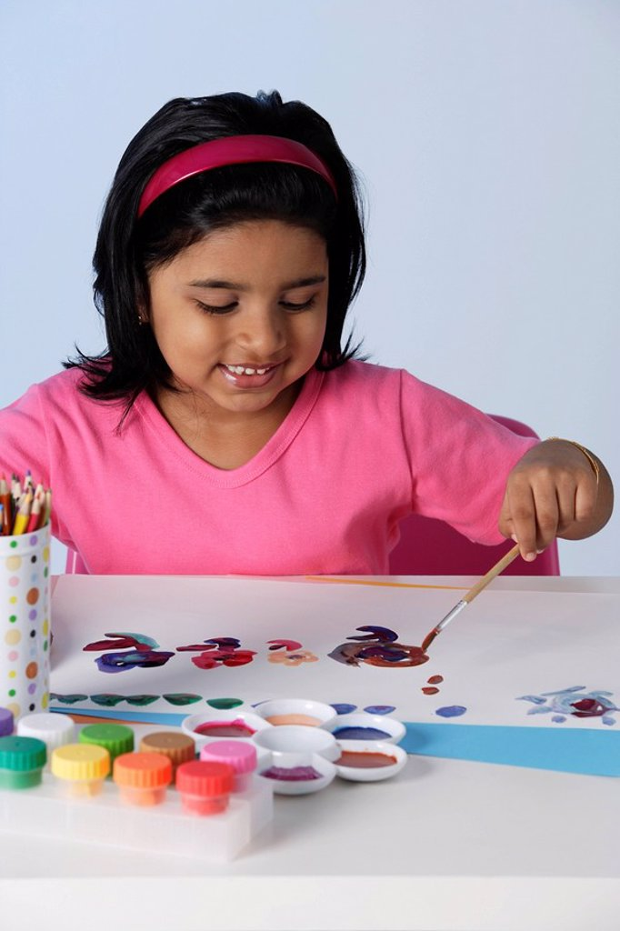 Stock Photo: 4078R-3339 Little girl painting