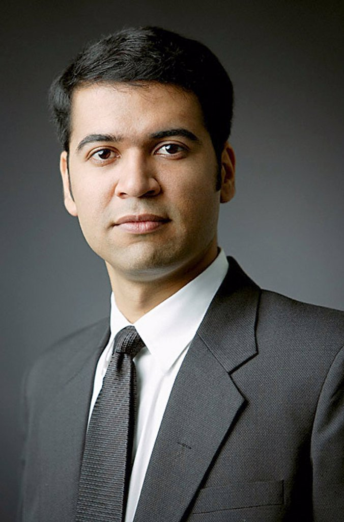 Businessman looking at camera, portrait : Stock Photo