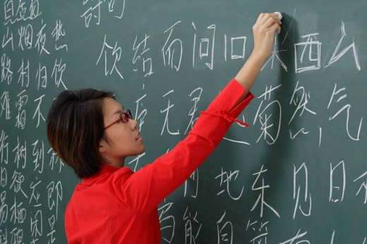 woman writing chinese characters on chalk board : Stock Photo