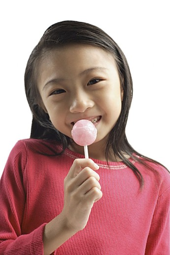 Girl eating lollipop : Stock Photo