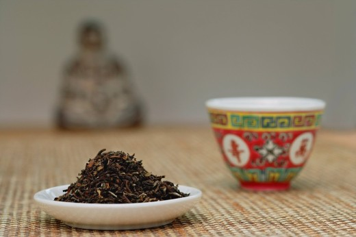 Chinese teacup and plate of tea leaves, still life : Stock Photo
