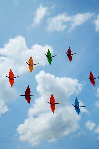 multiple paper cranes against sky backdrop : Stock Photo