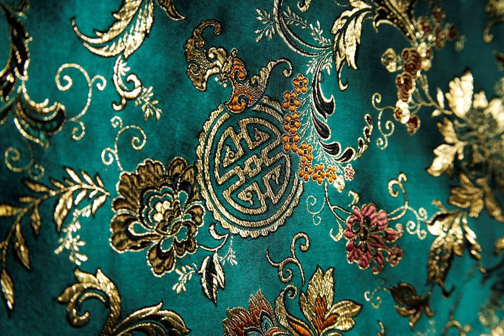 Detail of jade green Chinese silk fabric : Stock Photo