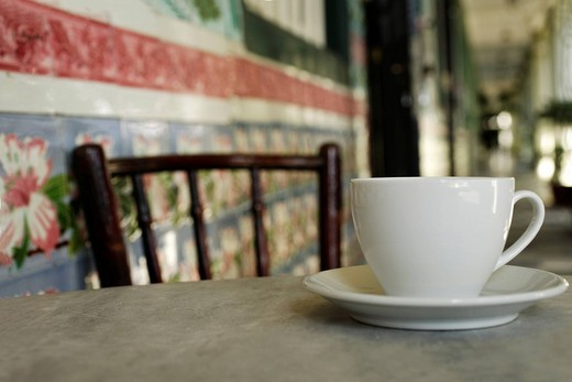 Close up of coffee cup on marble table in China Town, Singapore. : Stock Photo