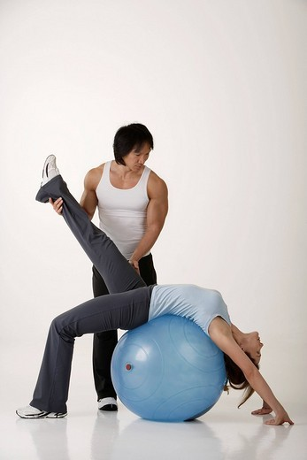 Man and woman working out : Stock Photo