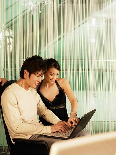 couple looking at computer : Stock Photo