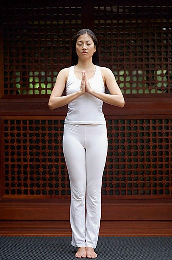 Stock Photo: 4079R-5434 Woman doing yoga, praying pose