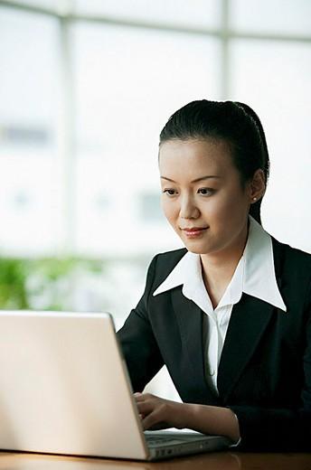 Stock Photo: 4079R-5775 Businesswoman using laptop