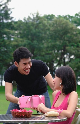 Man giving woman a gift : Stock Photo
