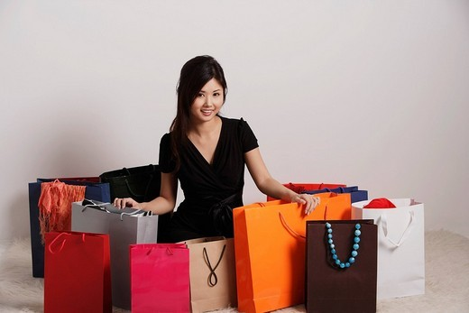 Stock Photo: 4079R-6255 Chinese woman with a lot of shopping bags
