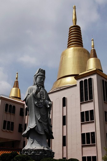 Golden spires and Buddhist Statue : Stock Photo