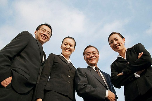 Stock Photo: 4079R-6671 Businessmen and businesswomen looking down at camera, smiling