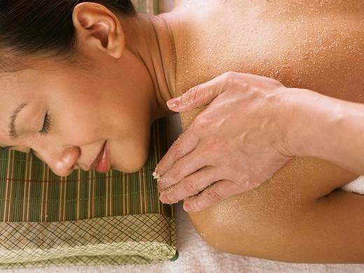 Stock Photo: 4079R-7072 young woman having a spa scrub