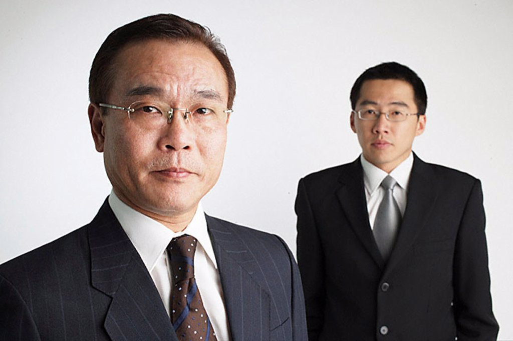 Two Businessmen looking at camera : Stock Photo