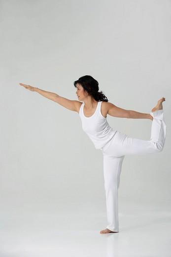Stock Photo: 4079R-8363 Woman practicing yoga