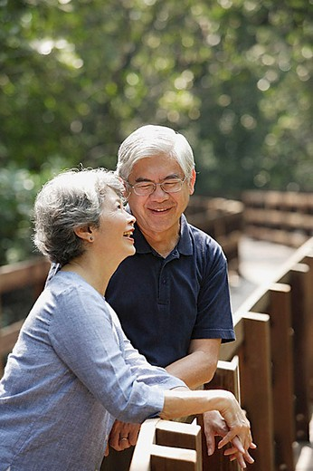 Stock Photo: 4079R-8377 Mature couple side by side, smiling, woman looking up