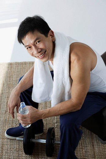 Stock Photo: 4079R-8493 Man smiling after work out
