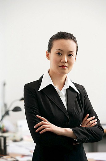 Stock Photo: 4079R-8893 Businesswoman standing with arms crossed, portrait